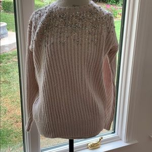 Light pink knitted blouse